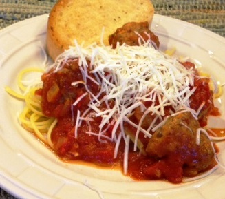Homemade meatballs over quinoa spaghetti noodles (infinitely better than those rice or corn gluten-free substitutes). All covered with cheese. Alas, the garlic bread is made of wheat.