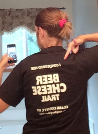 "I would flip this image for you, except I think the mirror selfie is sort of hokey, not unlike getting acquiring T-shirt on a trip. The last line on the T-shirt? ""Clark County, Ky.: The Birthplace of Beer Cheese."" Just in case you doubted."